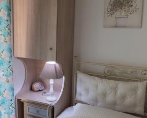 Moriel Seaside Homes Suites - bed