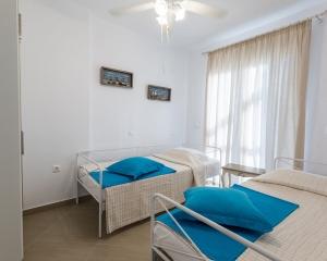 Moriel Seaside Homes Suites - bedroom
