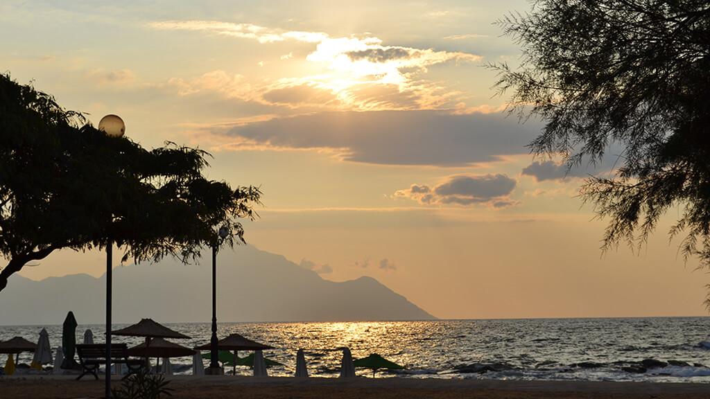 beach in the golden hour, Athos mountain