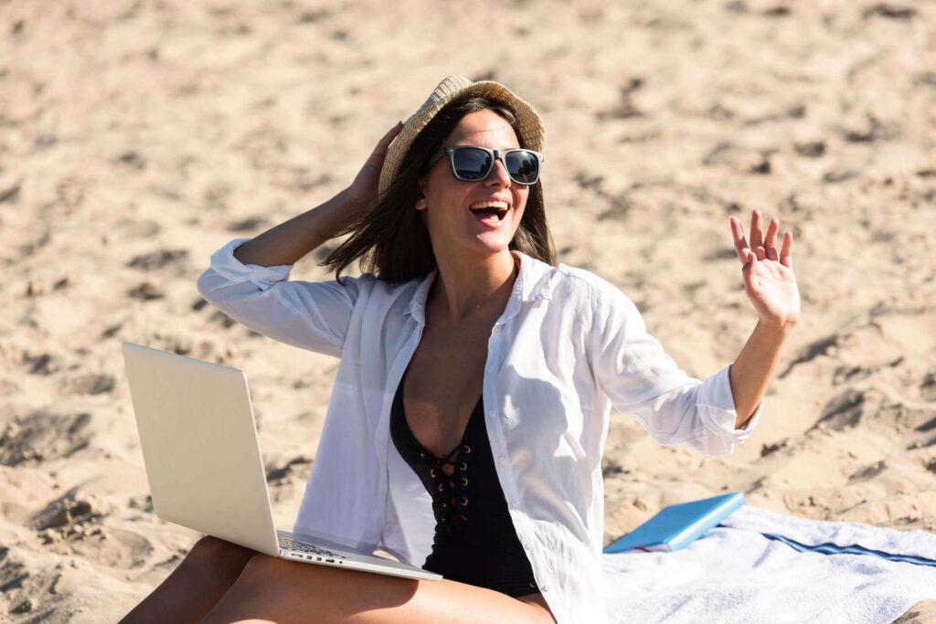 sithonia beach black girl with laptop