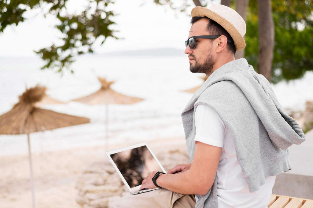 sithonia beach guy with laptop